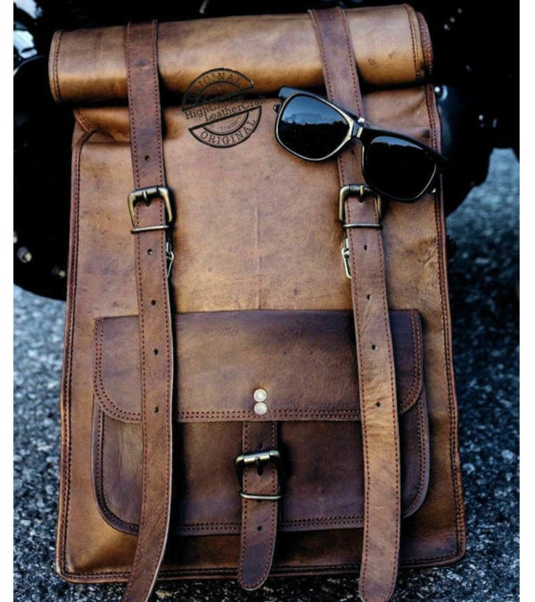 LEATHER ROLLED BACKPACK.